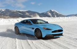 Astonishing Race Of Aston Martins Models On The Snow Covered Track