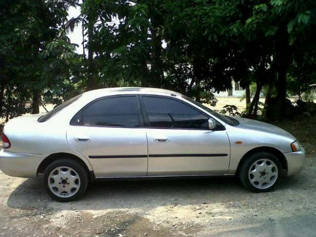 FORD LASER silver