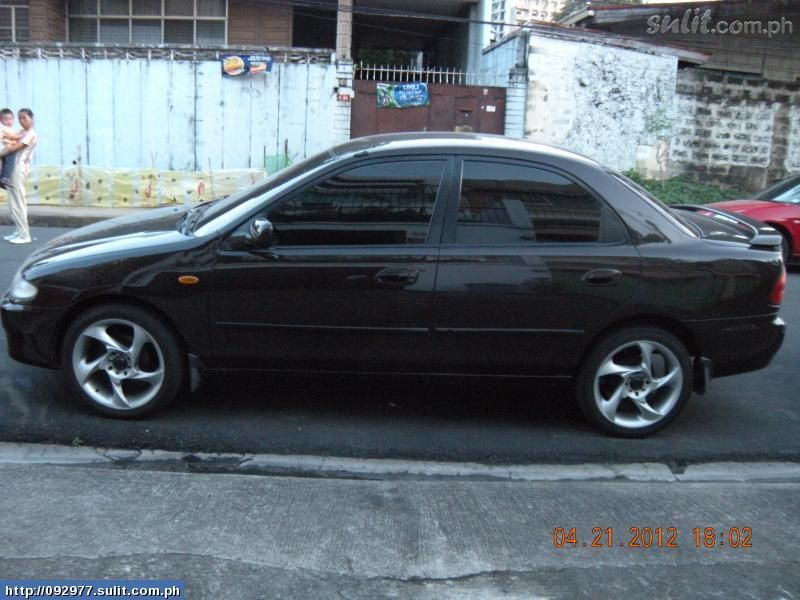 MAZDA FAMILIA brown