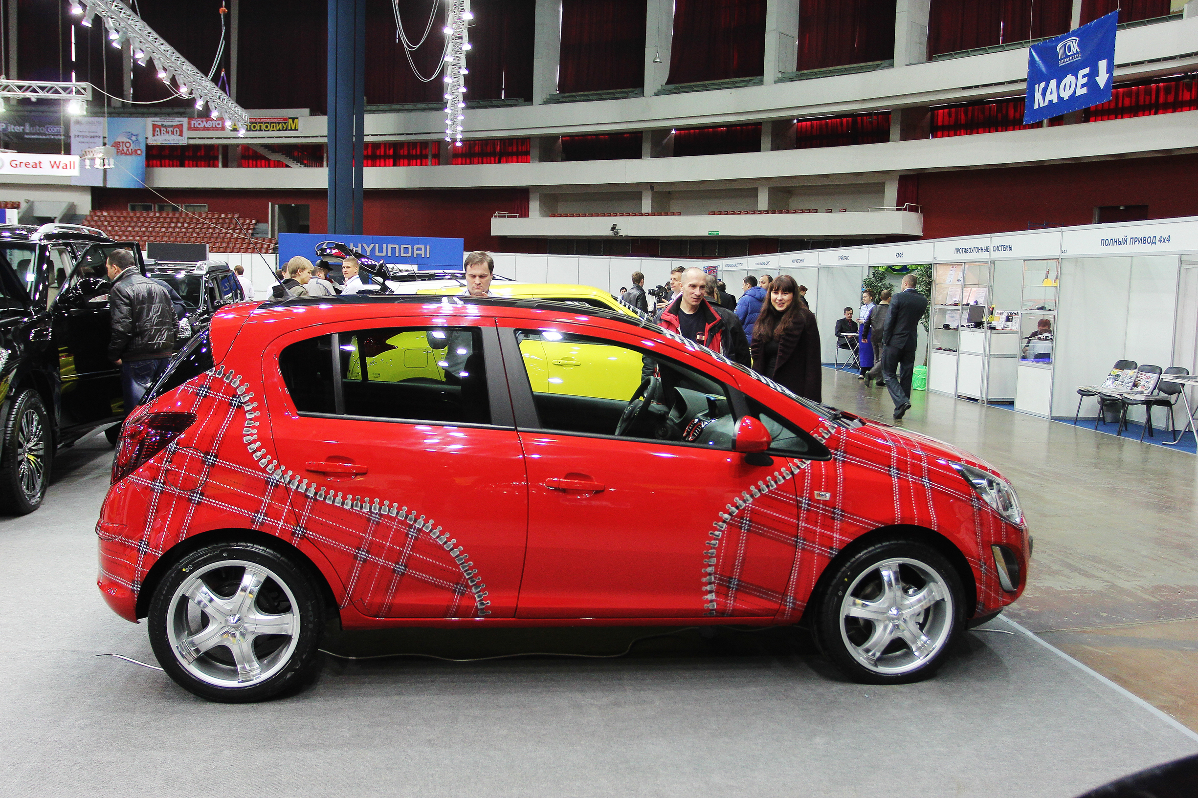 "ST. PETERSBURG, RUSSIA - APRIL, 5: OPEL CORSA WITH AEROGRAPHY PICTURE IS ON DISPLAY AT ""AUTOMOBILE WORLD-2012 "" ANNUAL CAR EXHIBITION ON APRIL, 5, 2012 IN ST.PETERSBURG, RUSSIA. BY UATP1"