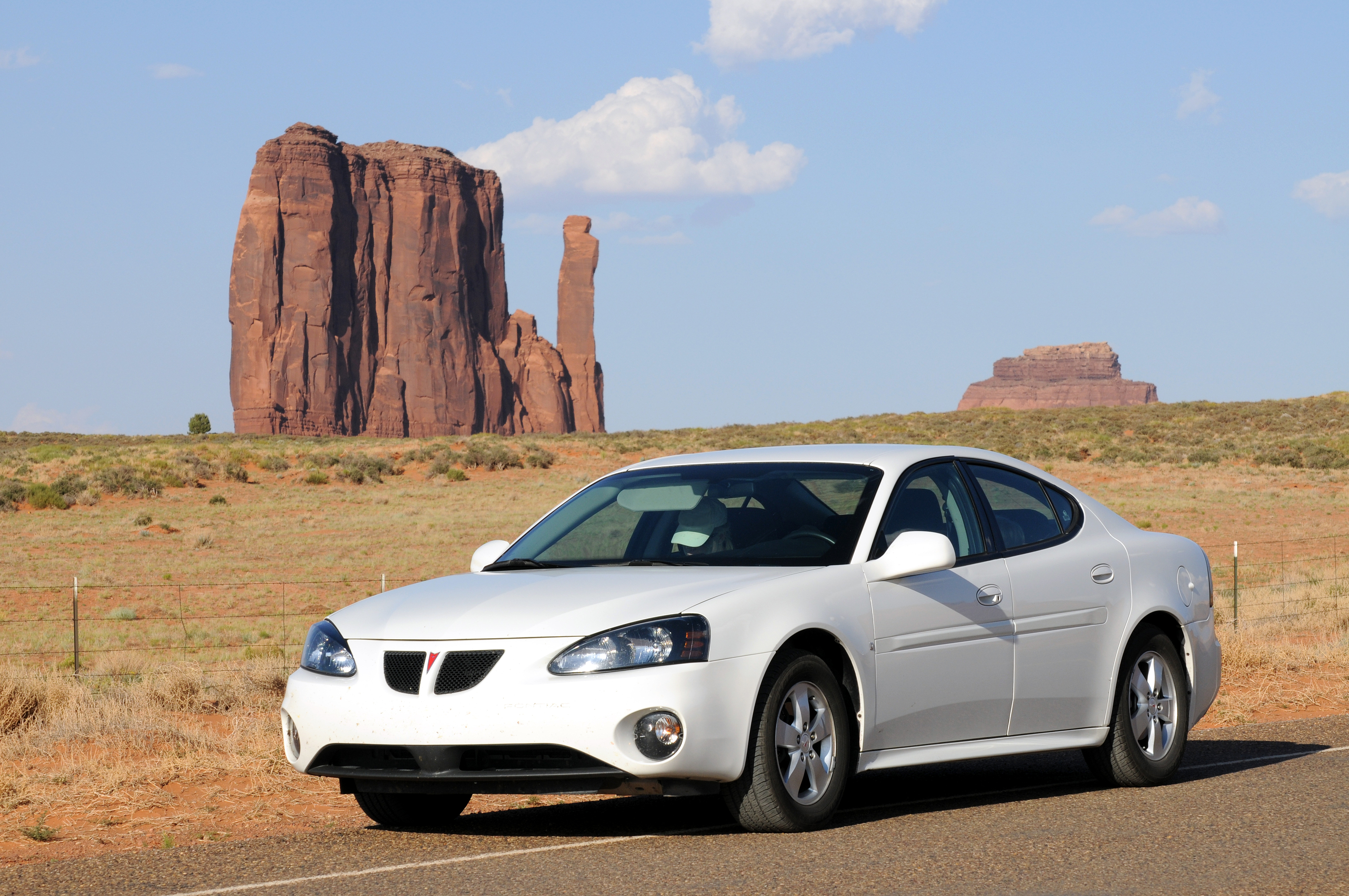 MONUMENT VALLEY, AZ - JUNE 22: SALES OF PONTIAC GRAND PRIX, PICTURED IN AN ICONIC DESERT SETTING IN MONUMENT VALLEY, ARIZONA, ON JUNE 22, 2008, ARE DOWN BECAUSE OF HIGH GAS PRICES. BY 1PHOTO