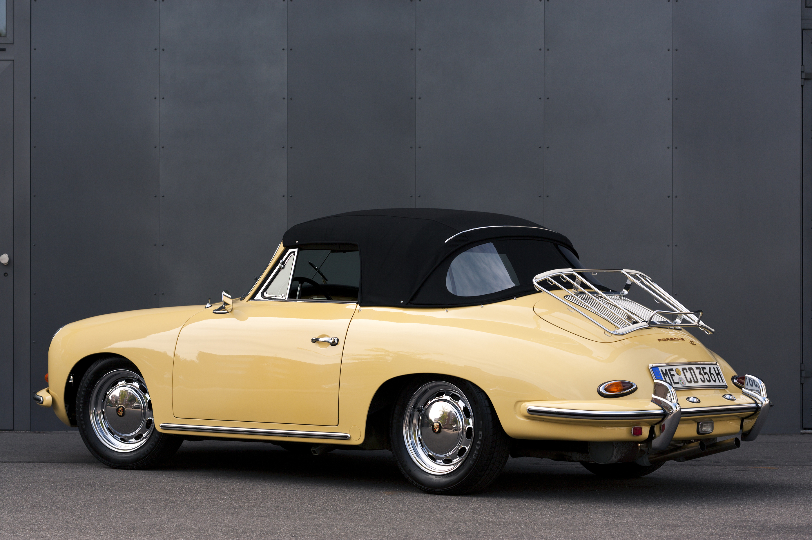 DUSSELDORF, GERMANY - JUNE 17, 2009: A PERFECTLY RESTORED LIGHT YELLOW PORSCHE 356 C CONVERTIBLE IN FRONT OF A GREY STEEL WALL. BY FOODBYTES