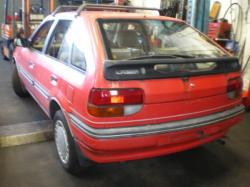 FORD LASER red