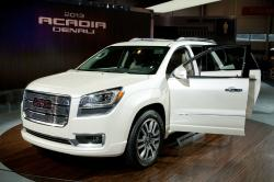 CHICAGO - FEB 12: The 2013 GMC Acadia Denali on display at the 2012 Chicago Auto Show. February 12, 2012 in Chicago, Illinois. by Yaro